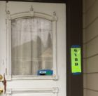 The permit on the door says we can get started renovating!